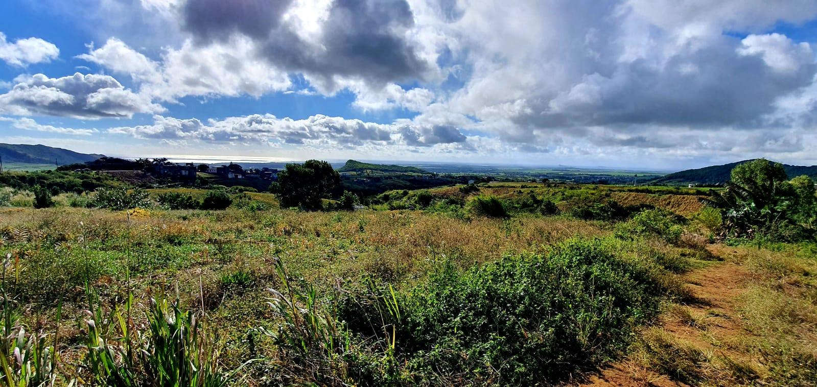 """FOR SALE – Agricultural land of 1 acre located at """"Les Mariannes""""withabeautifulview on the Coin de Mire and the sea. Ideal for an investment or other projects."""