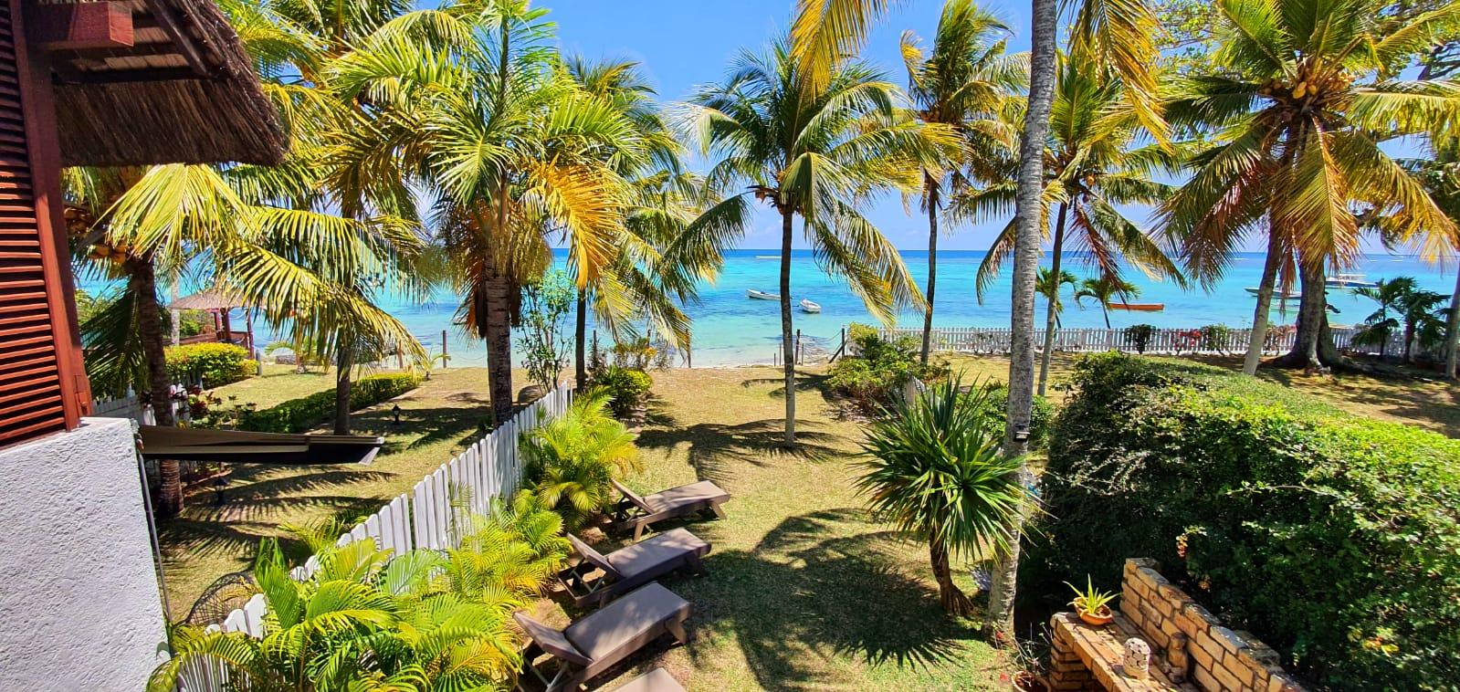 FOR SALE –  Magnificent beachfront duplex furnished and equipped of 131 m2on a land of 34 toisesenjoys an exceptional panoramic view of the crystal clear lagoon of Trou aux Biches